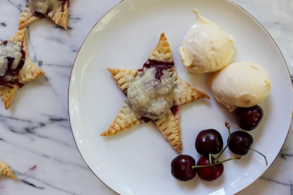Star-shaped cherry hand pie with vanilla ice cream. | Recipe on The Fruit Company blog