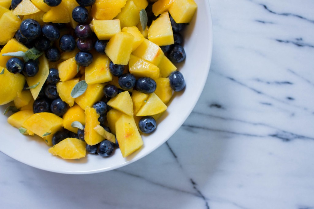 Peaches and blueberries prepped for a Peach Blueberry Crumble | Recipe on The Fruit Company Blog