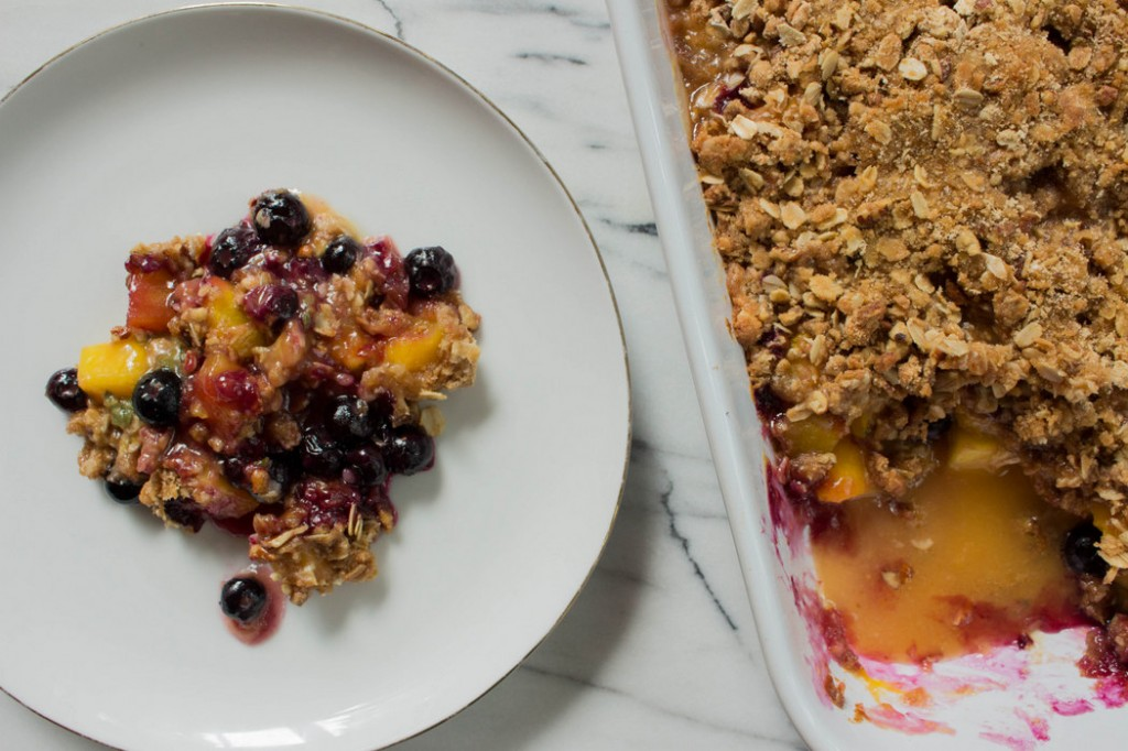 Dessert for breakfast? Add greek yogurt to this Peach Blueberry Crumble and call it breakfast. | Recipe on The Fruit Company Blog